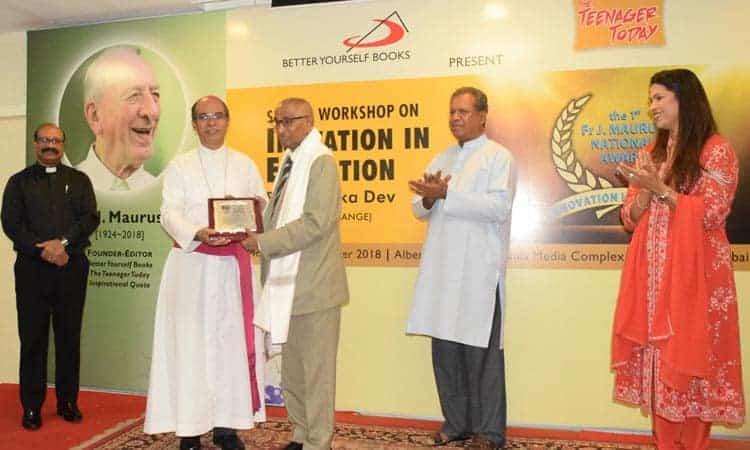 Dr. Jagdish Gandhi, Founder of City Montessori School, receiving award